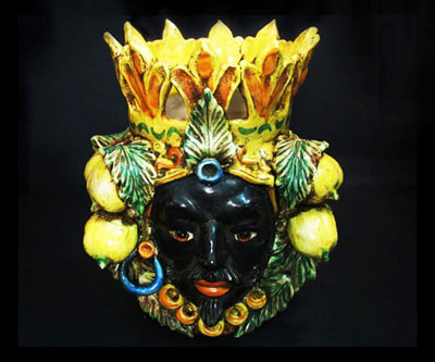 "A ""Moor's Head"" vase from Caltagirone; apparently the Africans in those days liked using fruit as hair grips."