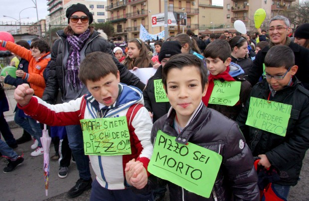 """Kids in Brancaccio recently, in a protest march against paying """"pizzo"""" (Mafia extortion money). The idea of doing something like this when my husband was their age would have been completely unthinkable."""