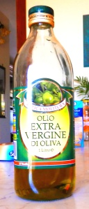 Mediterranean Man's penis extension: A one-litre bottle of olive oil, Extra Virgin type