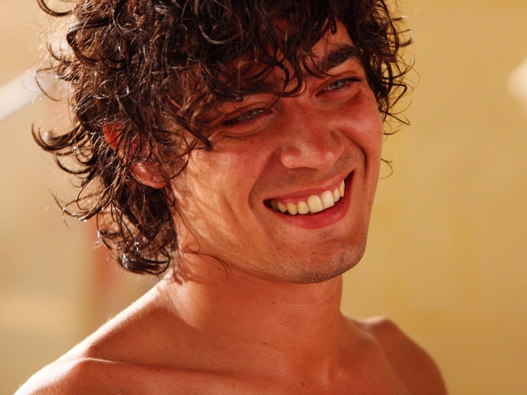 He looked a bit like this:  Italian actor Riccardo Scamarcio