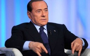 Former Italian president Silvio Bersusconi warding off the evil eye during a TV interview