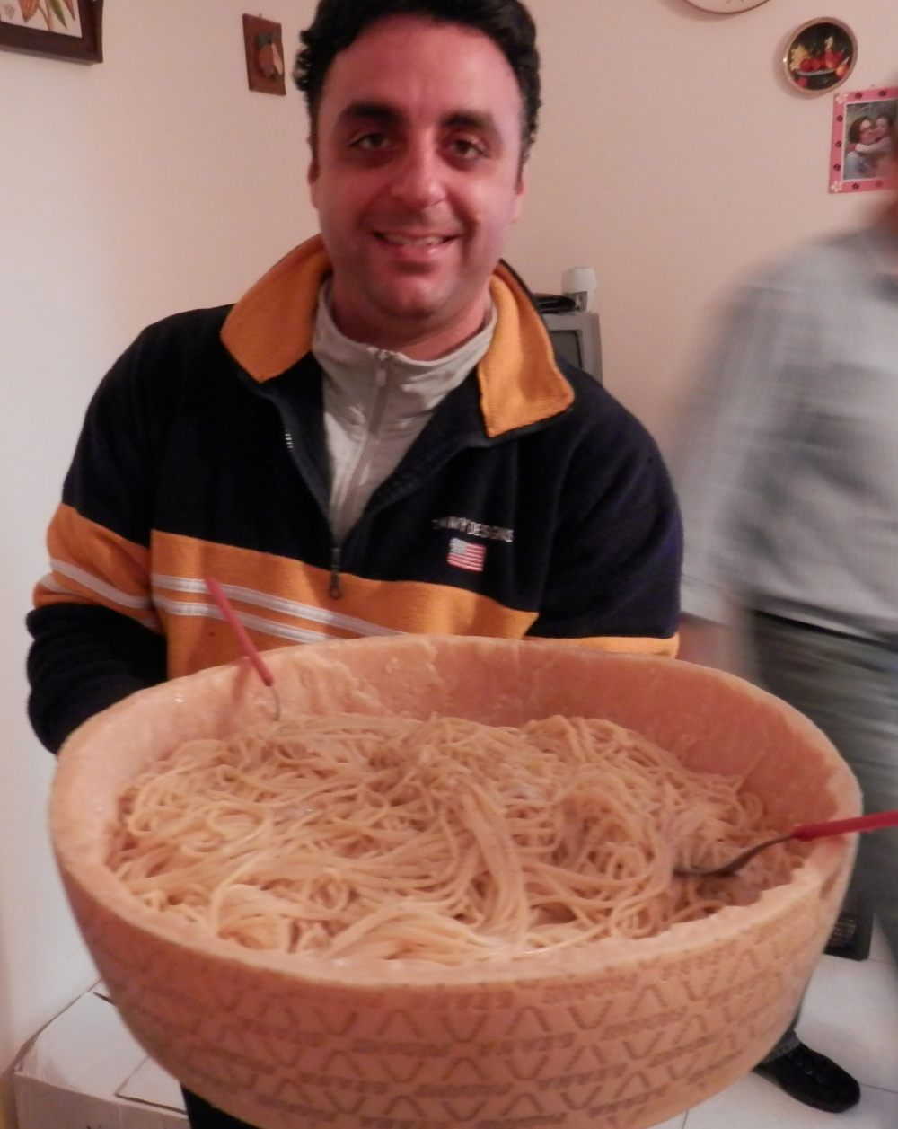 SicilianHousewife - spaghetti in a bowl carved of parmesan cheese