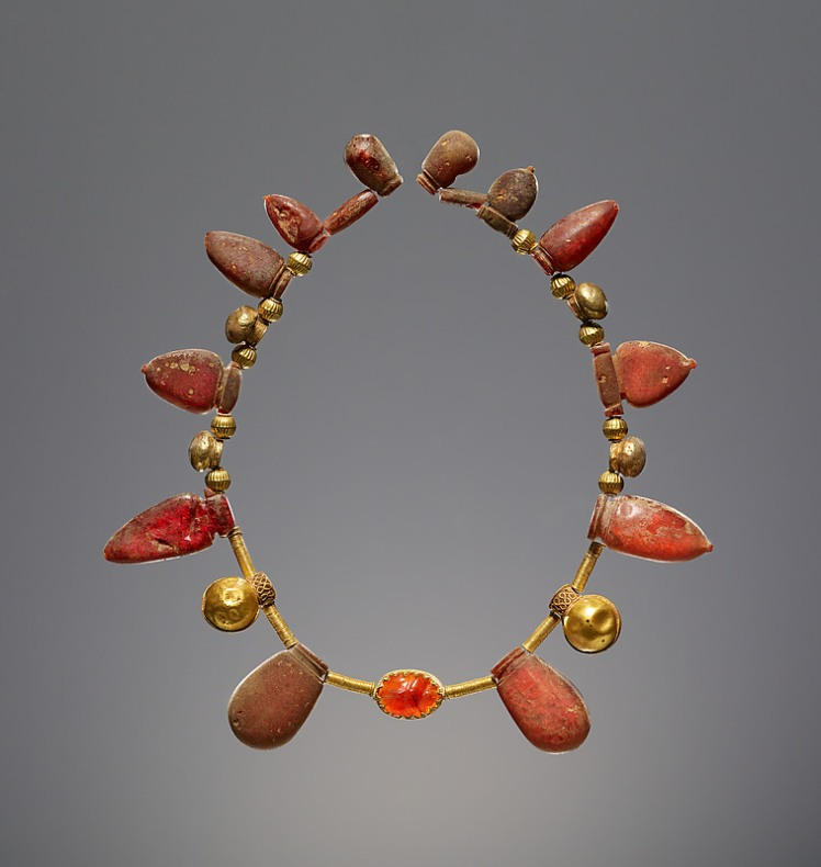 Ancient Roman Necklace with a Pendant Scarab made of simetite, 550–400 B.C. The necklace is simetite, gold, and carnelian, and it is in the J. Paul Getty Museum, Los Angeles