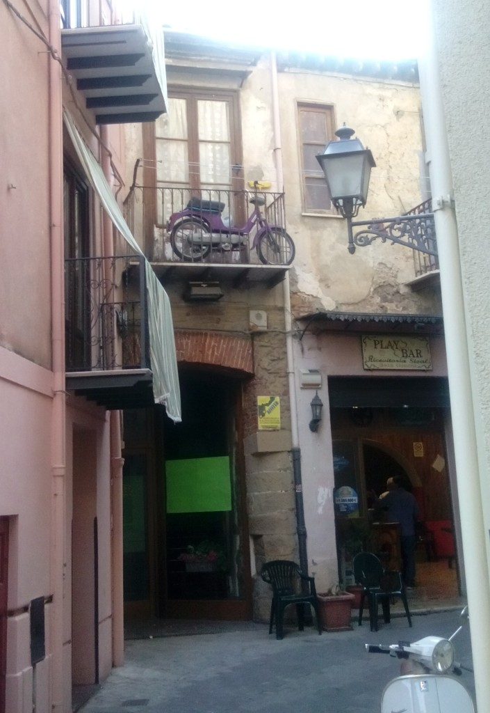 Motorbike on balcony - Dangerously Truthful Sicilian Housewife