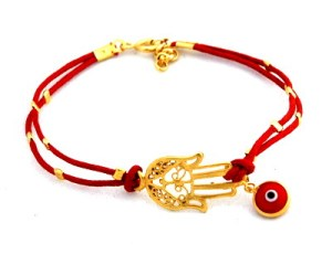 All the girls in the village are wearing these North African/ Middle Eastern charms against the evil eye nowadays! I had a fascinated group of them around me last night hearing me explain what the latest trend really means!